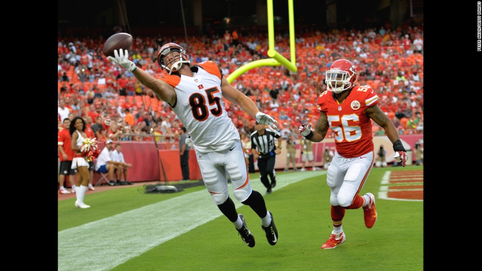 Cincinnati Bengals tight end Tyler Eifert tries to pull in a catch during an NFL preseason game Thursday, August 7, in Kansas City, Missouri. It was just out of his reach.