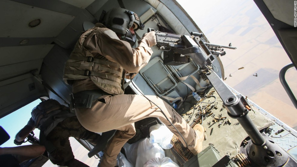 An Iraqi gunner opens fire at possible ISIS targets during a rescue operation by the Iraqi Air Force and Kurdish Peshmerga fighters on Monday, August 11. The dramatic operation at Iraq's Mount Sinjar involved taking supplies to desperate Yazidis and even bringing some aboard a helicopter to make it safely out of the area.
