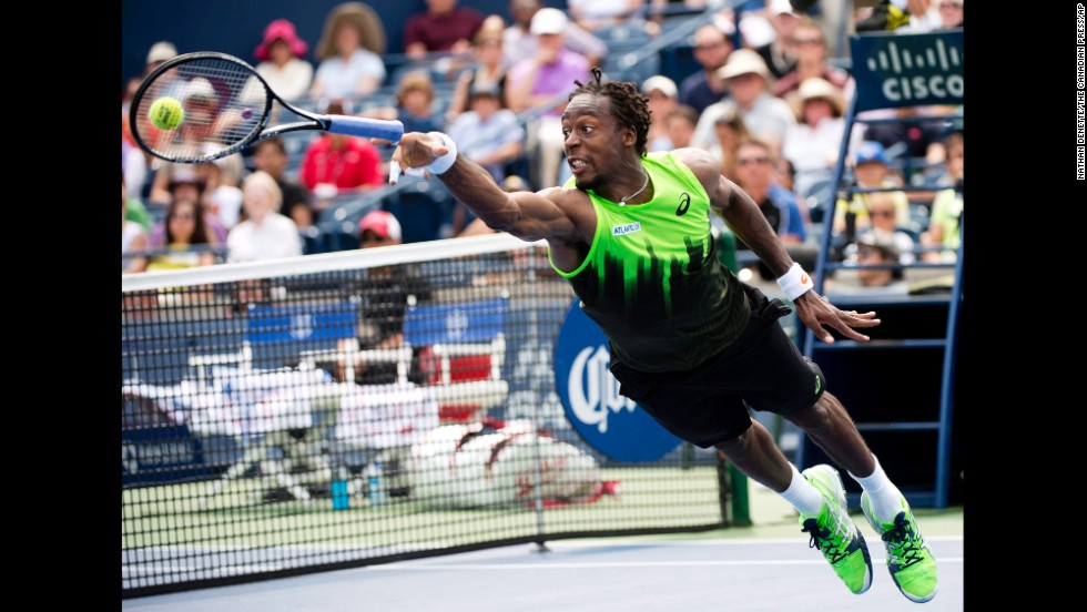 Gael Monfils loses his racket as he dives for the ball during his Rogers Cup match against Novak Djokovic on Wednesday, August 6, in Toronto. Djokovic won the second-round match in three sets.