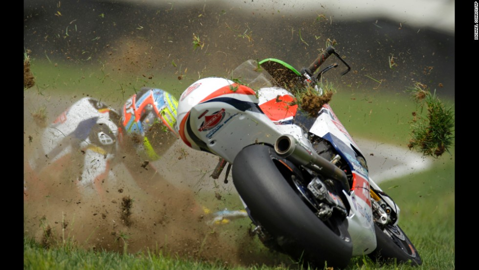 Xavier Simeon crashes during a Moto2 race Sunday, August 10, at Indianapolis Motor Speedway. He did not finish the race, but he was OK.