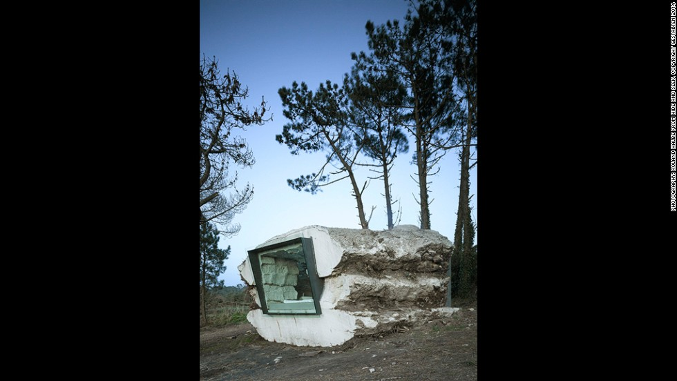 "<em>The Truffle, Spain</em><br /><br />This rugged dwelling is described by designers <a href=""http://www.ensamble.info/actualizacion/projects/truffle"" target=""_blank"">Ensamble Studio</a> as a ""piece of nature built with earth, full of air."" So it's perhaps fitting that a calf called Paulina did much of the building work. Bales of hay were tightly stacked on the ground forming a mass that concrete was poured over. Once dry, cuts were made into the amorphous stone so that Paulina the calf could start eating the hay inside.<br /><br />It took her a year to get through the hay and when she was done, she had grown into a 300 pound adult. Ensamble turned the space she left into a hideout that is both organic and contemporary, with stunning views of the coastline of Galicia out of the window. <br />"