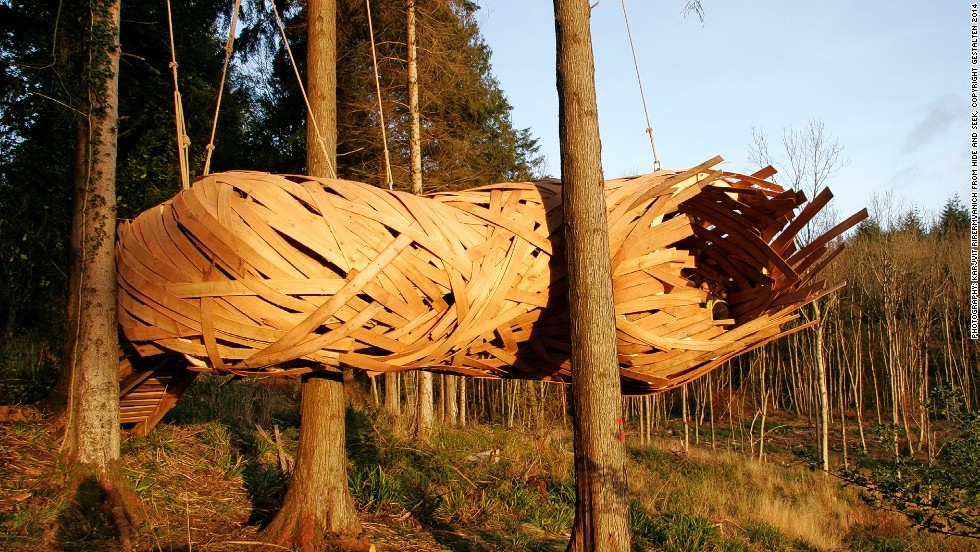 "<em>Cocoon, United Kingdom</em><br /><br />This inhabitable cocoon has literally been woven into the landscape, using cedar strips. It is a monocoque structure, meaning that its load is supported by the skin, working in much the same way as an egg shell.<br /><br />The site-specific hideout, by <a href=""http://designandmake.aaschool.ac.uk/)"" target=""_blank"">AA Design & Make</a>, sits at the edge of a forest clearing in Hook Park, South West England, and is designed with the aim of visitors closer to the trees and giving them a great spot to watch the sunset."