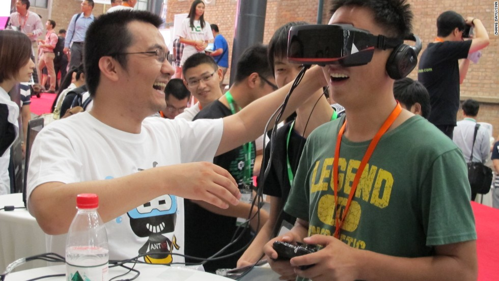 A visitor plays with a gaming helmet designed by Beijing-based company ANTVR. The device allows its user to fully immerse themselves in the virtual experience.
