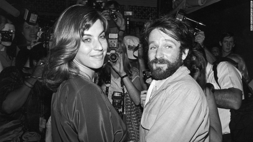 Williams and his first wife, Valerie Velardi, join a huge number of photographers packed into singer Paul Simon's apartment to celebrate Simon's wedding to actress Carrie Fisher in New York City on August 16, 1983.