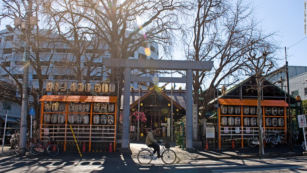 """Tokyo cyclists use practical """"mamachari"""" bikes with sturdy frames, baskets for shopping and seats containing one or two small children. Up to 14% of all journeys in the city are made by bike."""