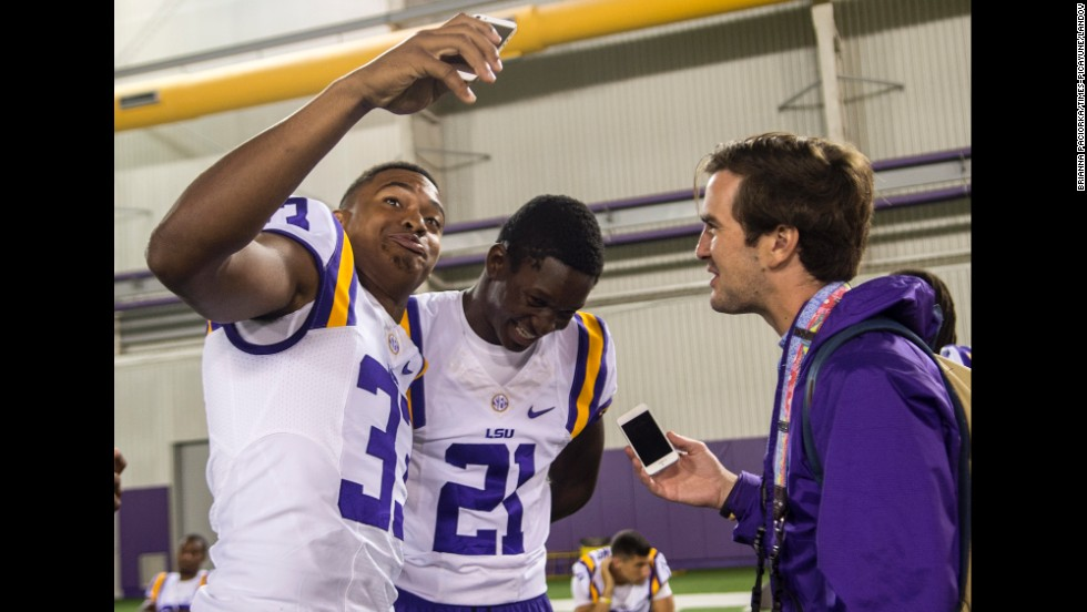 LSU safety Jamal Adams tries to take a selfie with teammate Rashard Robinson during the football team's media day Sunday, August 10, in Baton Rouge, Louisiana.