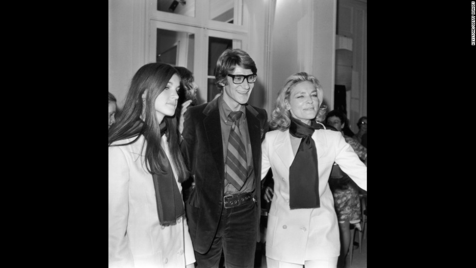 French designer Yves Saint-Laurent with Bacall and her daughter Leslie at a showing of his latest collection in Paris in 1968.
