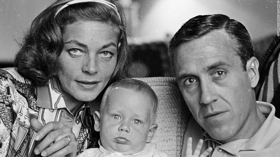 Bacall poses with her second husband, actor Jason Robards, and their baby son Sam in 1962.