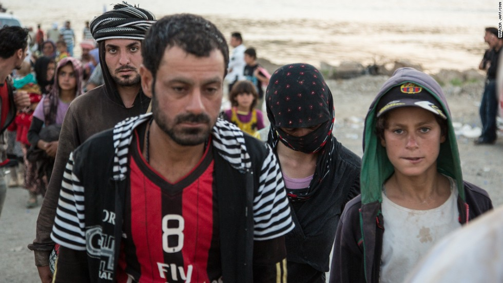 Yazidis fled into the barren and windswept Sinjar Mountains more than a week ago after ISIS captured their town.