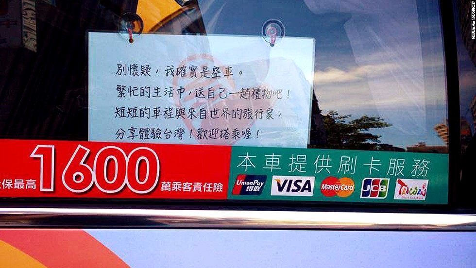 "This sign says: ""Give yourself a gift in this busy life and meet a globetrotter during your short ride. Share experiences of Taiwan and welcome on board!"""