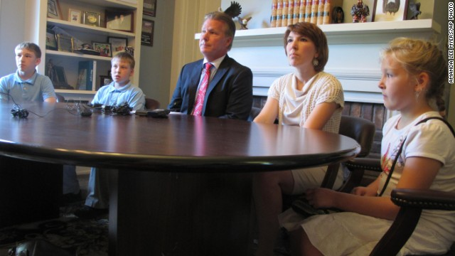 The family of Jeffrey Edward Fowle sit with their attorney, Tim Tepe, during a news conference regarding the American, who is currently detained in North Korea.