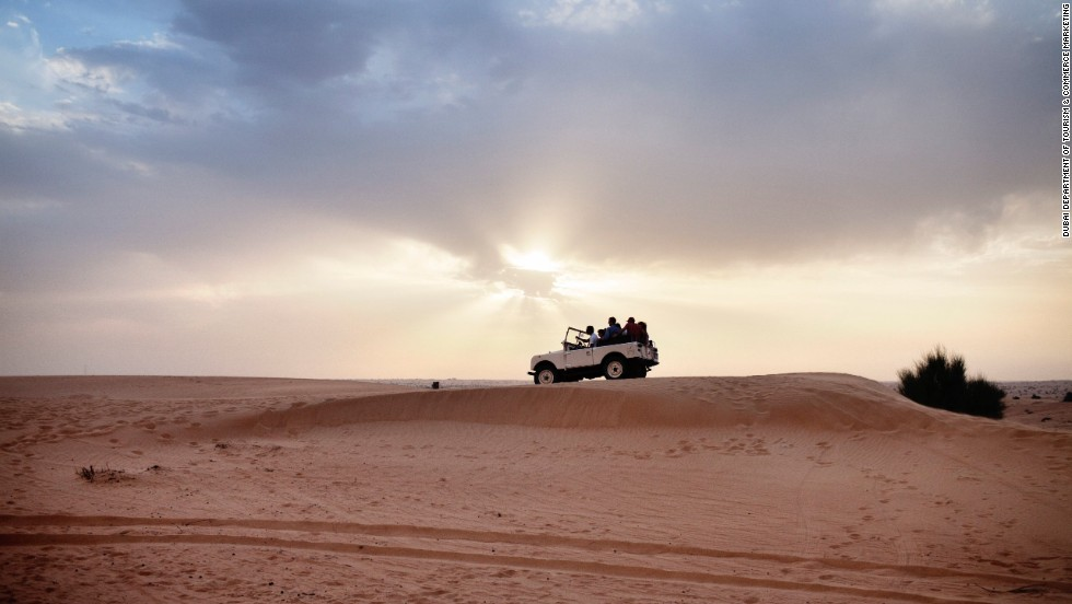 In the Dubai desert, camel rides, temporary henna tattoos and belly dancing are a desert drive away from a stunning and remote campsite with low-slung tables and pillows for seats.