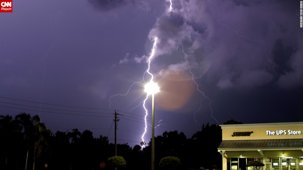 "It's only an optical illusion, but lightning appears to be striking a lamppost in this June photo from <a href=""http://ireport.cnn.com/docs/DOC-1141887"">Billy Ocker</a>. ""The storm was wicked strong,"" he remembered."