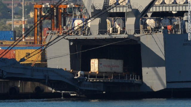 Syrian chemical weapons are transferred from a Danish freighter to a U.S. military ship on July 2, 2014 in Gioia Tauro, Italy.