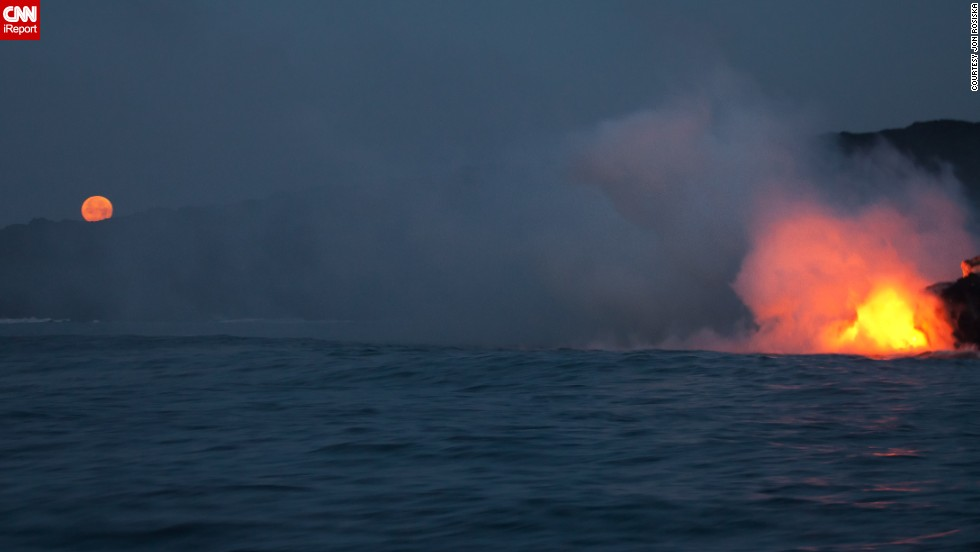 "<a href=""http://ireport.cnn.com/docs/DOC-967646"">Jon Rosiska</a> photographed lava flowing into the ocean while traveling along the Big Island's coastline in April 2013."