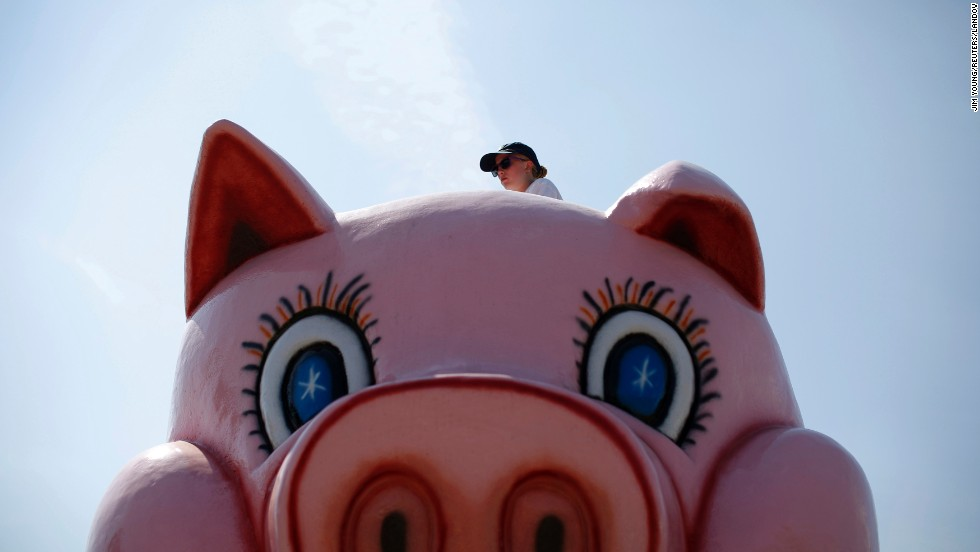 A worker is seen at the top of a ride at the Wisconsin State Fair in West Allis, Wisconsin, on Saturday, August 9. The fair, which has been around for 150 years, mixes agricultural exhibits with amusement rides.