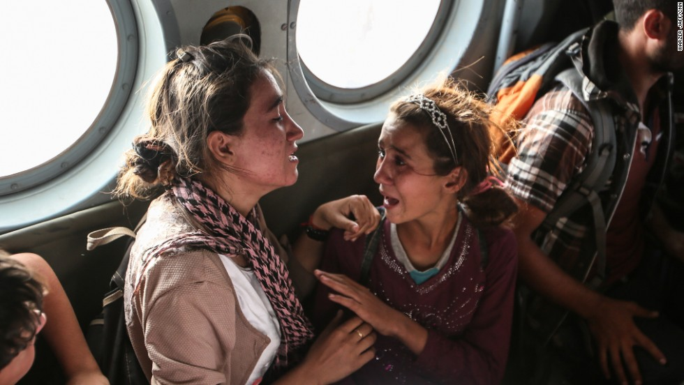 Aziza Hamid, a 15-year-old Iraqi girl, cries for her father while she and some other Yazidi people are flown to safety Monday, August 11, after a dramatic rescue operation at Iraqs Mount Sinjar. A CNN crew was on the flight, which took diapers, milk, water and food to the site where as many as 70,000 people were trapped by ISIS. But only a few of them were able to fly back on the helicopter with the Iraqi Air Force and Kurdish Peshmerga fighters.