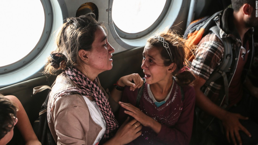 "Aziza Hamid, a 15-year-old Iraqi girl, cries for her father while she and other Yazidi people are flown to safety after a <a href=""http://www.cnn.com/2014/08/11/world/gallery/kurdistan-rescue-mission-mount-sinjar/index.html"">dramatic rescue operation</a> at Iraq's Mount Sinjar on August 11, 2014. A CNN crew <a href=""http://www.cnn.com/2014/08/11/world/meast/iraq-rescue-mission/index.html"">was on the flight,</a> which took diapers, milk, water and food to the site where as many as 70,000 people were trapped by ISIS. Only a few of them were able to fly back on the helicopter with the Iraqi Air Force and Kurdish Peshmerga fighters."