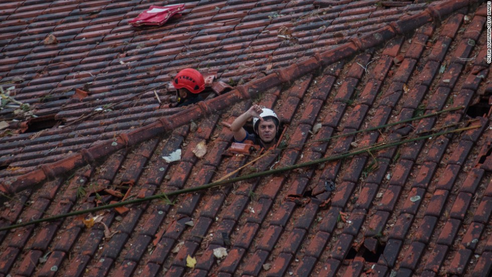 "Emergency crews in Santos, Brazil, survey the damage of a <a href=""http://www.cnn.com/2014/08/13/world/gallery/brazil-plane-crash/index.html"">plane crash</a> that killed Brazilian presidential candidate Eduardo Campos and six others on Wednesday, August 13. The small plane was carrying Campos to a campaign stop when it crashed into a residential neighborhood, state-run Agencia Brasil reported. The country's Air Force said the crash was due to bad weather, but it is continuing to investigate the accident."