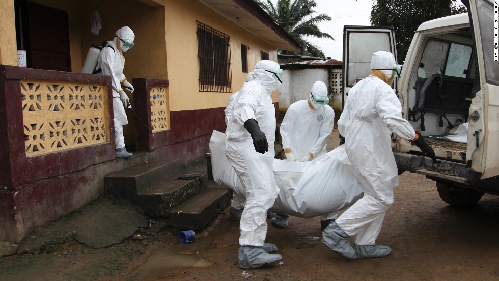 "Nurses carry the body of an Ebola victim from a house outside Monrovia, Liberia, on Friday, August 8. Health officials say the current <a href=""http://www.cnn.com/2014/04/04/world/gallery/ebola-in-west-africa/index.html"">Ebola outbreak in West Africa</a> is the deadliest ever. The virus has killed more than 1,000 people this year in Guinea, Liberia, Nigeria and Sierra Leone."