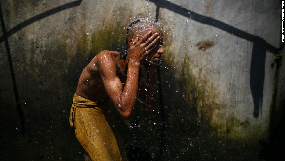 A Hindu priest takes a holy bath as part of a ritual during the Janai Purnima Festival in Kathmandu, Nepal, on Sunday, August 10. During the festival, Hindus take holy baths and change their sacred thread, also known as Janai, for protection and purification.