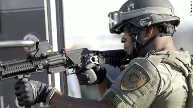 Ferguson cops: Protecting or escalating?
