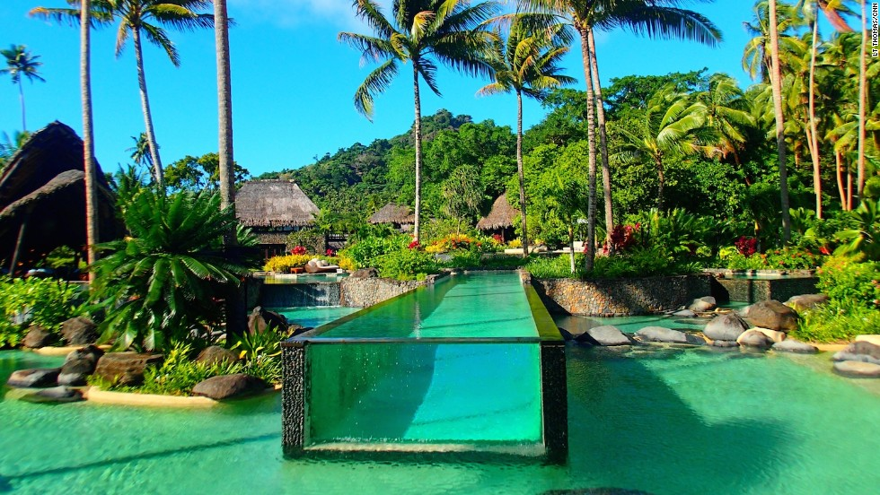 "Laucala Island's main pool comes with its own human-sized ""fish tank."""