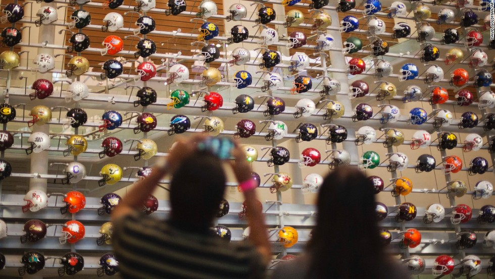 Helmets representing all 768 four-year college football programs across the country greet visitors in the lobby at the new College Football Hall of Fame in Atlanta.
