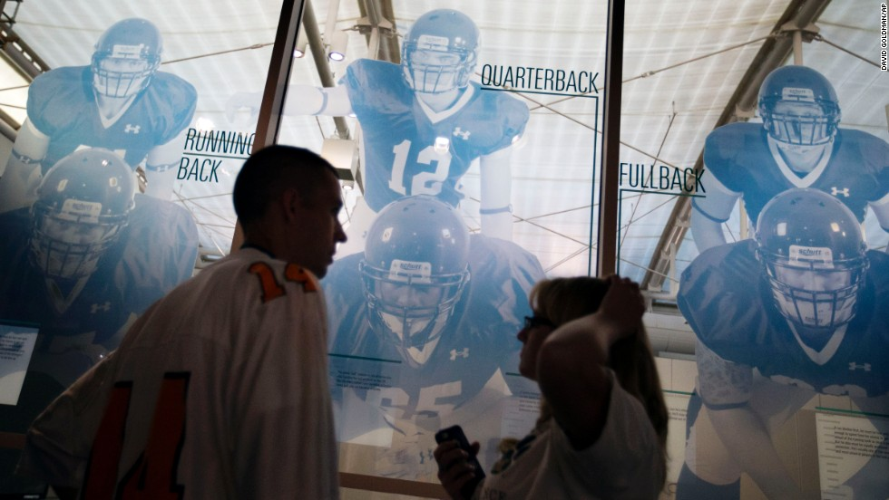 Visitors tour the hall before spending the night. The College Football Hall of Fame was previously in South Bend, Indiana, but it was plagued by poor attendance.