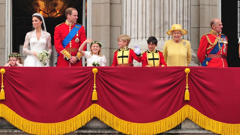 The Queen, second from right, greets a crowd from the balcony of Buckingham Palace on April 29, 2011. Her grandson Prince William, third from left, had just married Catherine Middleton.
