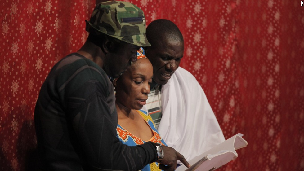 """Mulenga Kapwepwe stands on stage providing script direction while preparing her latest play, """"Rufino's Wife."""" Kapwepwe says: """"That again was inspired by the fact that there were members of my family: my uncles, my father's sister's husband for example, who went and fought in the Second World War. And it struck me that the Second World War actually had an impact on my family and the village that we come from. But you don't hear those stories anywhere. What happened tot he Africans who fought in the war who came back to their villages. What is the story?"""""""