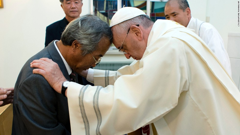 In Seoul on August 17, Pope Francis greets the father of one of the victims of the sinking of a South Korean ferry that killed more than 300 people, most of them high school students, earlier this year.