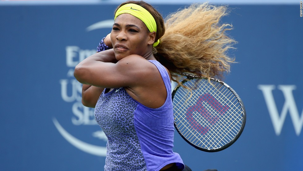 "With her hair -- <a href=""/2012/08/15/sport/tennis/serena-venus-roddick-williams-tennis/index.html"" target=""_blank"">which she once described as ""super crazy""</a> -- tied back, Serena blasts a shot in a match against Ana Ivanovic in Cincinnati."