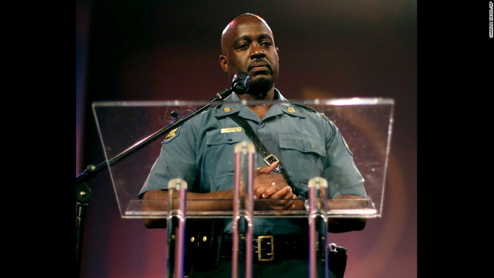 Capt. Ron Johnson of the Missouri State Highway Patrol speaks at the rally. He had been appointed by the governor to take control of security operations.