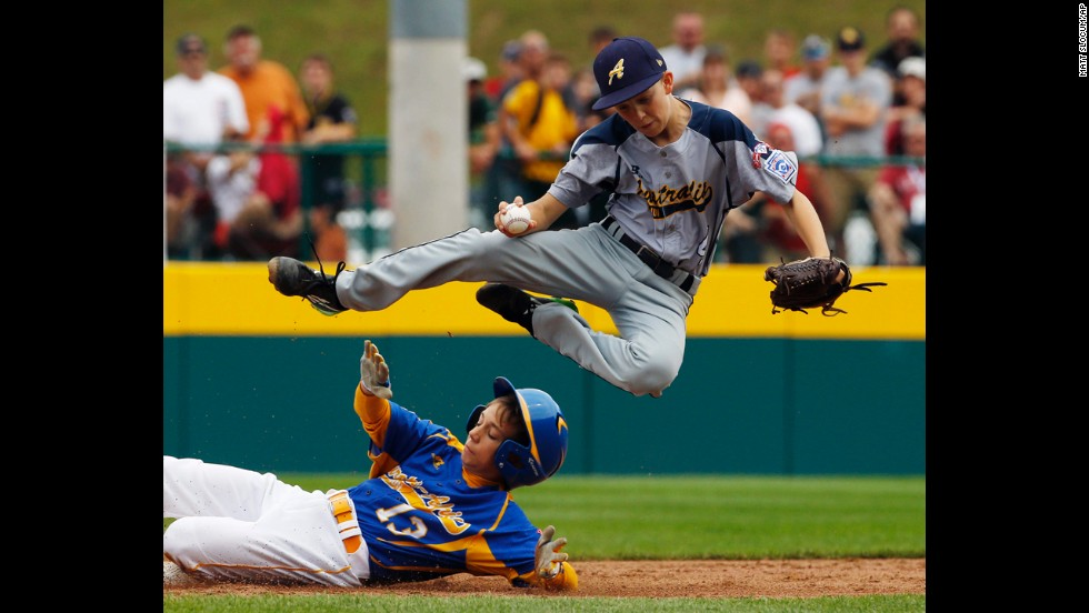 Australia's Calvin Eissens, top, leaps in the air to avoid a slide from Marek Krejcirik of the Czech Republic during a Little League World Series game Saturday, August 16, in South Williamsport, Pennsylvania. Australia won the game 10-1 to advance in the tournament's international bracket.