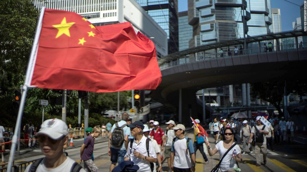A group of pro-China protesters marches in downtown Hong Kong on August 17. Local media accused organizers of paying people to participate in the Anti-Occupy Central protest.