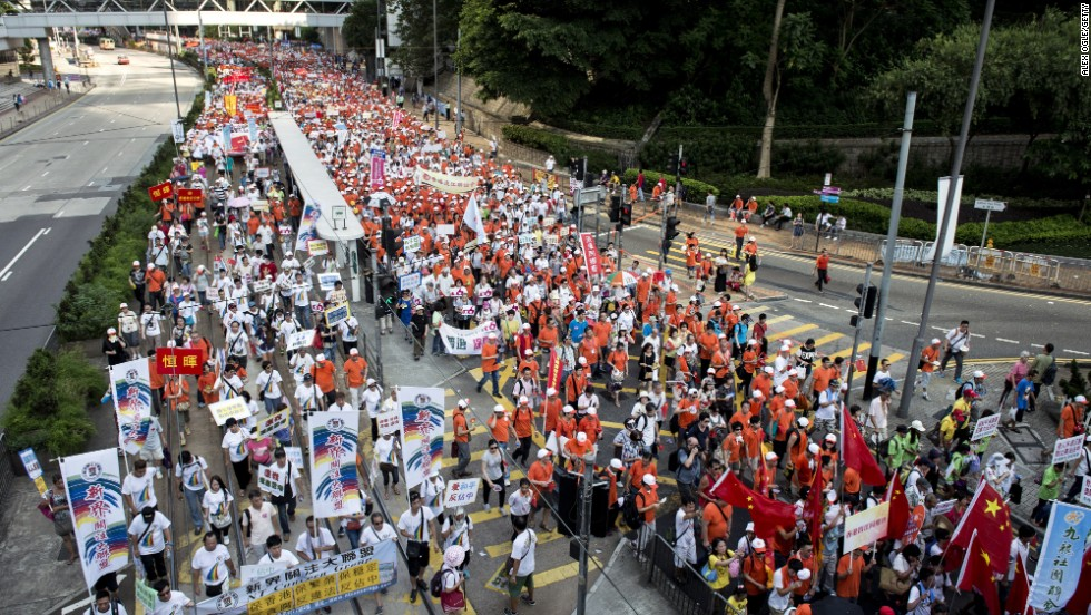 Tens of thousands of people marched through Hong Kong on Sunday, August 17 in support of China and to protest Occupy Central, a pro-democracy movement that says it will plan to stage a civil disobedience sit-in unless the Chinese government allows the Hong Kong public to nominate and vote for its next leader.