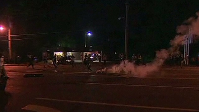 Police launch tear gas into crowd