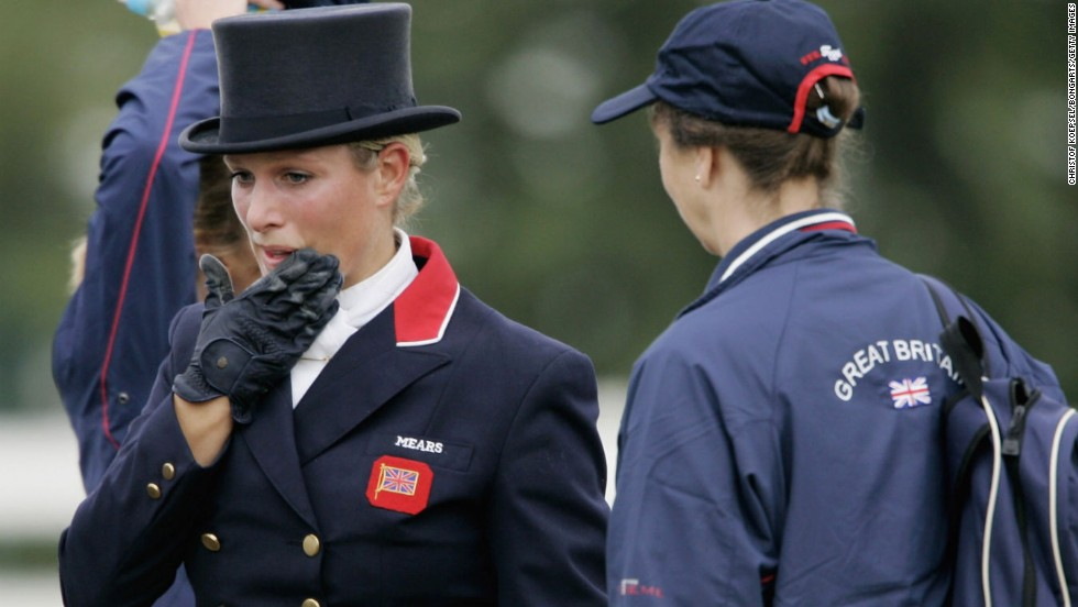The same year Zara Phillips, granddaughter of Britain's Queen Elizabeth, won the eventing world title. Here, she talks to her mother -- Princess Anne -- following the dressage section of the contest.