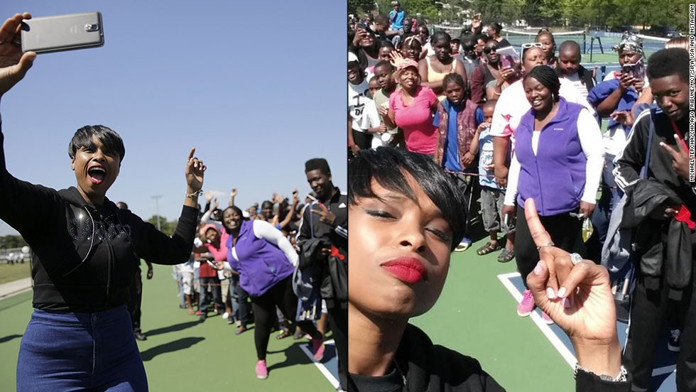 "Actress and singer Jennifer Hudson <a href=""http://instagram.com/p/rsFvqQOEmB/"" target=""_blank"">takes a selfie</a> with people waiting in line for school supplies Thursday, August 14, as part of the Hatch Day celebration in Chicago. Hudson and her sister, Julia, organize the event every year to honor Julia's late son, Julian, on his birthday."