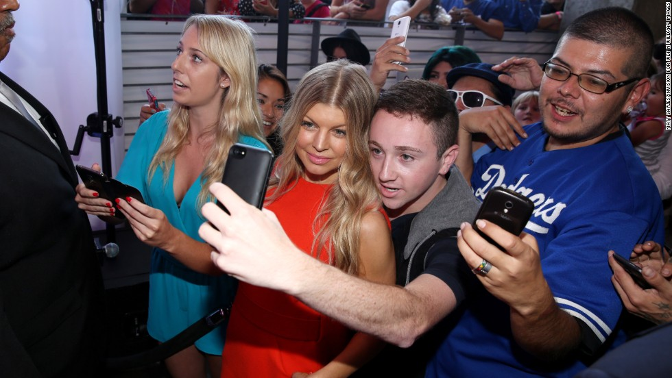 Singer Fergie smiles for a fan Thursday, August 14, at a launch event for #MoreKisses, a campaign organized by the Wet N Wild cosmetics company to benefit the American Cancer Society. According to the company, 25 cents of each Think Pink lipstick sold will be donated to the health organization.