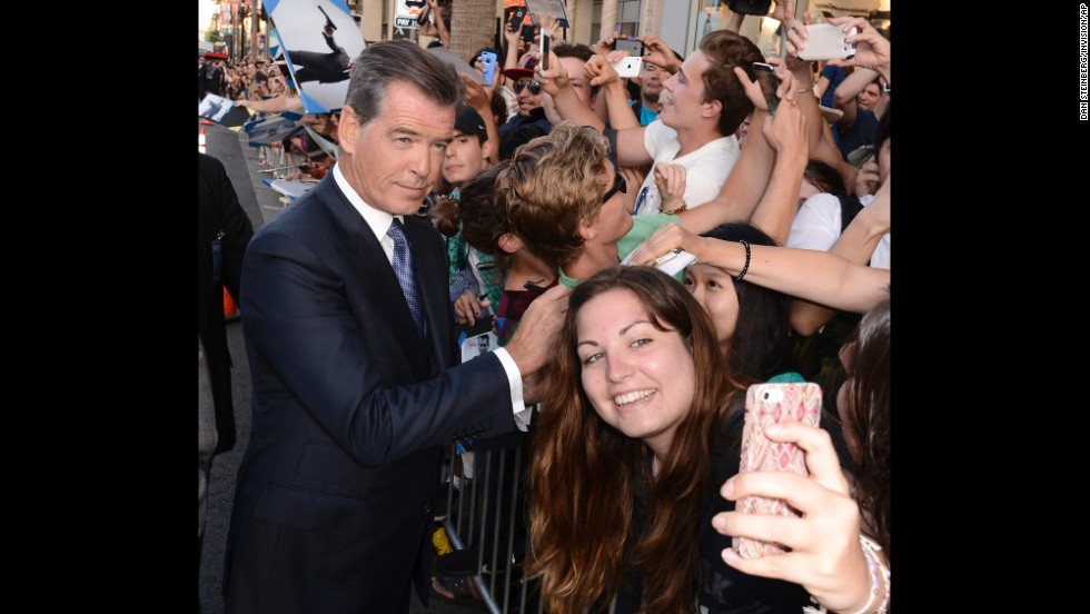 """Actor Pierce Brosnan attends the premiere of the film """"The November Man"""" at TCL Chinese Theatre in Los Angeles on Wednesday, August 13."""
