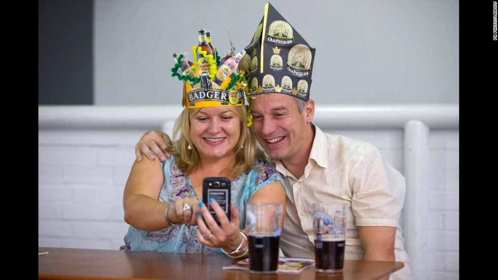 Visitors take a selfie at the Great British Beer Festival on Thursday, August 14, in London.