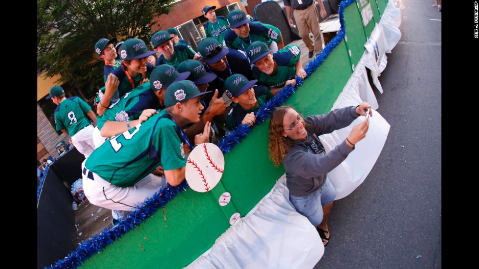 In this photo taken with a fisheye lens, Stephanie Tempesco snaps a selfie Wednesday, August 13, with members of a Little League Baseball team from Rapid City, South Dakota. The team was competing in the Little League World Series, which is held every year in South Williamsport, Pennsylvania.