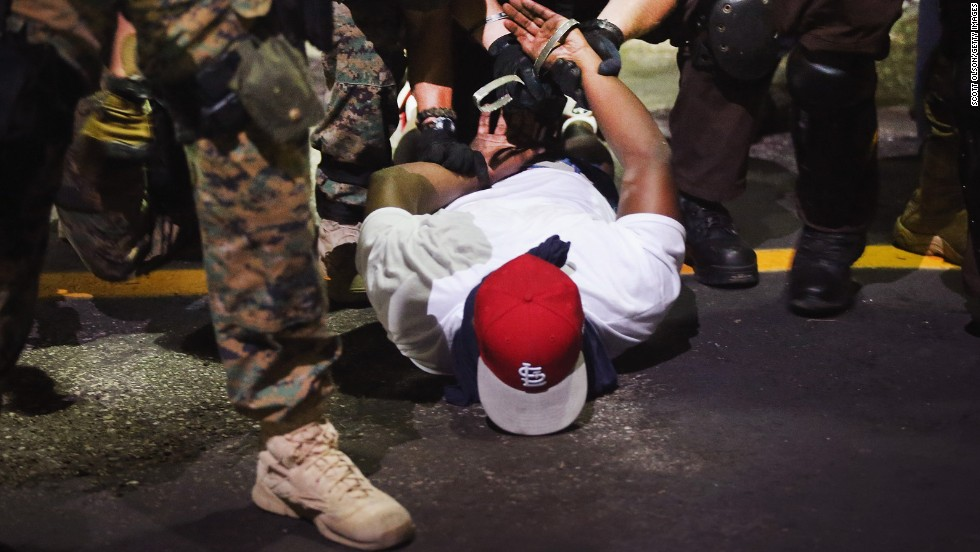 Police arrest a demonstrator on August 19, 2014.