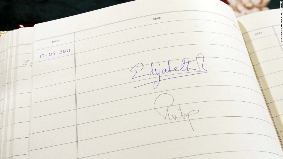 The Queen's signature is seen in the visitors book at Aras An Uachtarain, the Irish President's official residence in Dublin, Ireland, in May 2011.