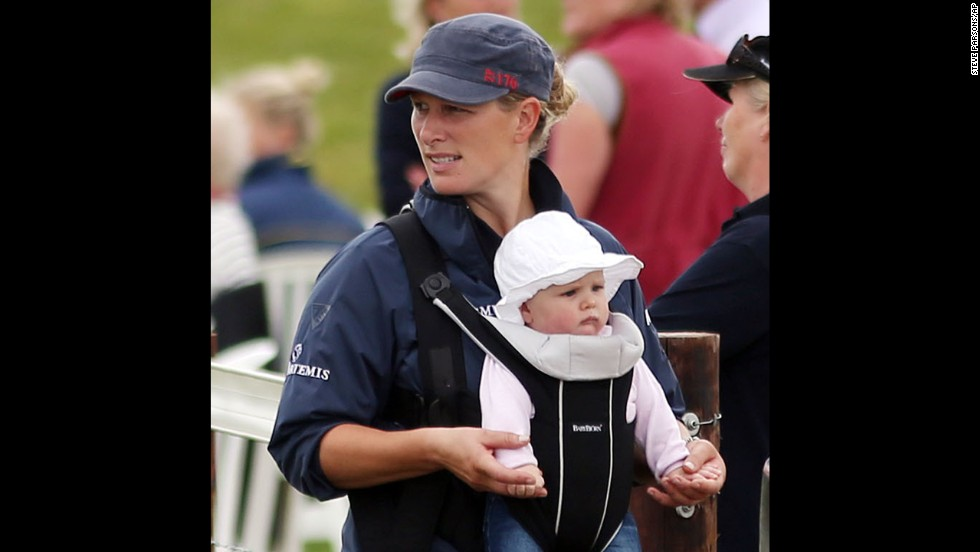 Zara Phillips holds daughter Mia Grace, born in January, during horse race trials in July. Phillips, a granddaughter of Queen Elizabeth II, is the daughter of Princess Anne and a cousin of Princes William and Harry. She is married to rugby player Mike Tindall.