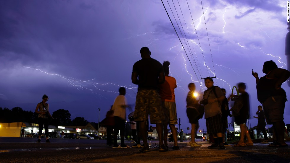 Lightning streaks over protesters on August 20, 2014.