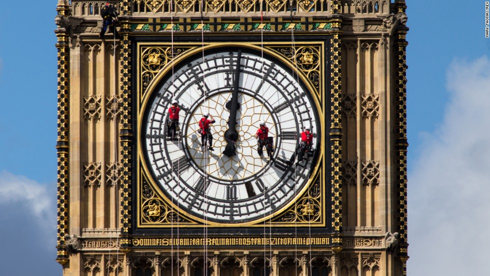 Workers clean the south face of Big Ben, the famous landmark at London's Palace of Westminster, on Tuesday, August 19.