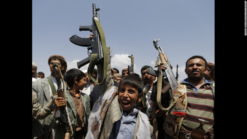 A boy holds up a weapon as he attends an anti-government gathering held by followers of the Shiite Houthi group in Arhab, Yemen, on Sunday, August 17. The Houthis, who control much of the northern Saada province bordering Saudi Arabia, are trying to consolidate their power as the country moves toward a federal system that gives more power to regional authorities.